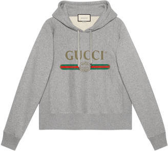 Hooded cotton sweatshirt with Gucci print $1,200 thestylecure.com