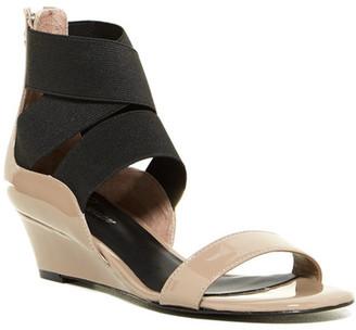 Delman Catch Wedge Sandal $278 thestylecure.com