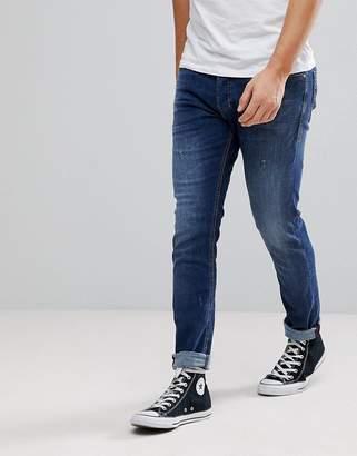Diesel Tepphar Jeans in Mid Wash