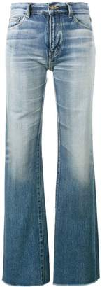 Saint Laurent raw-cut flared jeans