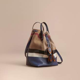 Burberry Canvas Check and Leather Bucket Bag $1,095 thestylecure.com