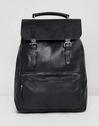 Asos DESIGN leather backpack in black with front pocket and double straps