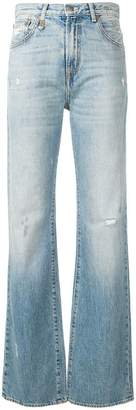 R 13 distressed flared jeans