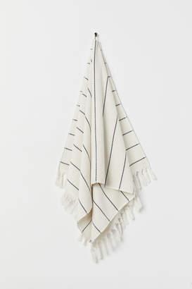 H&M Tasselled bath towel