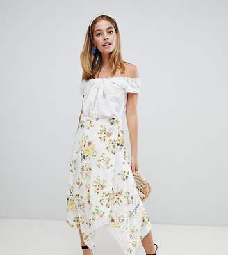 Asos DESIGN Petite wrap midi skirt in floral print with lace inserts