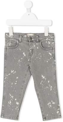 Gucci Kids splattered bleached jeans
