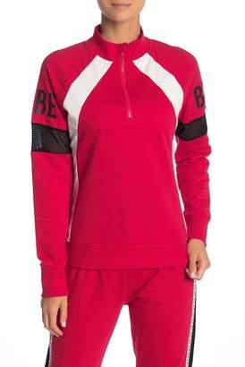 Bebe Colorblocked Mesh Sleeve 1\u002F4 Zip Pullover