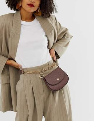 Asos Design DESIGN saddle purse waist and hip belt in horse shoe print