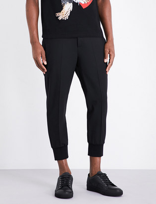 Neil Barrett Slim-fit cropped trousers $340 thestylecure.com