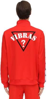 80e142bdb4d15 GUESS X J Balvin Vibras Collection Logo Zip Up Crewneck Sweater