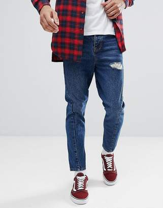 Asos DESIGN Twisted Seam Tapered Jeans In Dark Wash Blue With Rips