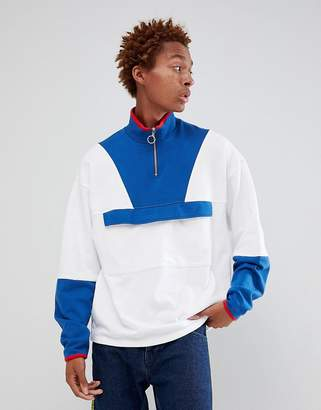 Asos DESIGN oversized sweatshirt with half zip and map pocket
