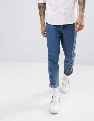 Asos DESIGN Twisted Seam Tapered Jeans In Dark Wash Blue