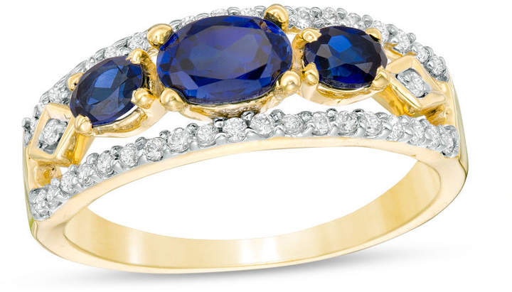 Zales Sideways Oval Lab-Created Blue Sapphire and 1/4 CT. T.W. Diamond Three Stone Ring in 10K Gold