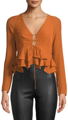 Alexis Reagan Long-Sleeve Lace-Up Peplum Top