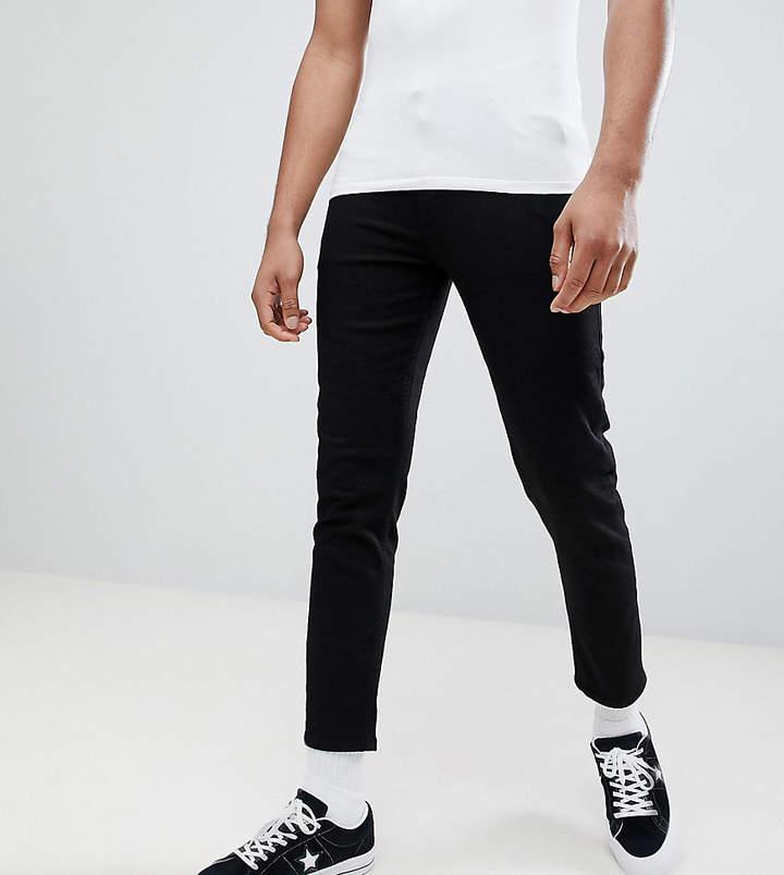 DESIGN Tall – Superenge schwarze Jeans im kurzen Schnitt