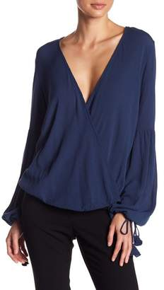 Love Stitch Surplice Neck Blouse