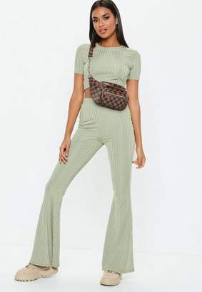 Missguided Green Shiny Ribbed Flare Trousers