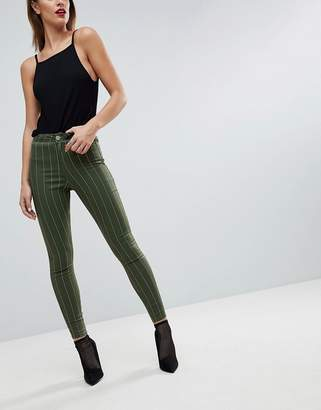 Asos DESIGN RIVINGTON High Waisted Denim Jeggings In Khaki With Neon Pink Stripe Print