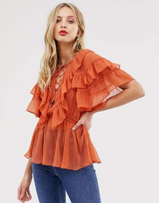 Asos Design DESIGN ruffle sleeve top with lace up detail