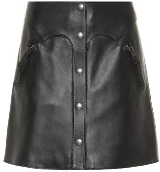 Coach Snap-front leather miniskirt