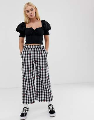 Lazy Oaf relaxed trousers in gingham with cherry embroidery