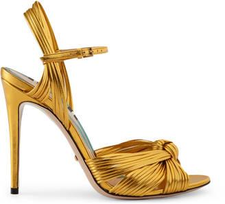 Metallic gold sandal $795 thestylecure.com