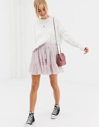 Glamorous ruffle mini skirt with dobby mesh overlay