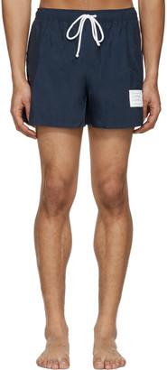 Thom Browne Navy Classic Stripe Swim Trunks $390 thestylecure.com