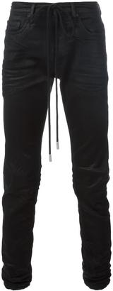 Off-White coated denim jeans $543 thestylecure.com