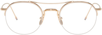 Thom Browne Gold TB-903 Glasses $575 thestylecure.com