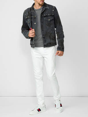 Gucci Studded denim jacket with hand bouquet print