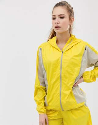 Asos 4505 4505 running jacket with zip detail stone and yellow
