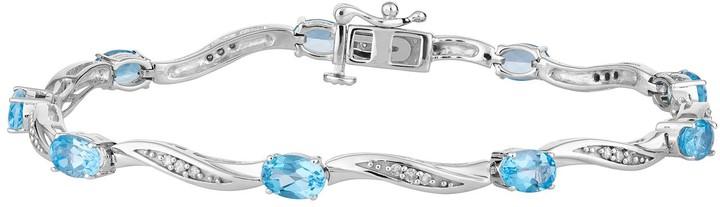 10k White Gold Swiss Blue Topaz & 1/5 Carat T.W. Diamond Bracelet