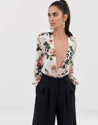 78898ae975 Flounce London thong bodysuit with plunge front in floral print