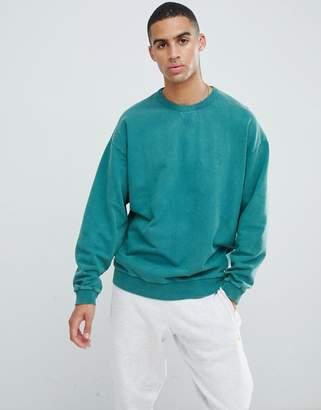 Asos DESIGN oversized sweatshirt with acid wash in green