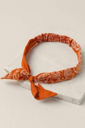 francesca's Lisa Bandana Print Bow Headwrap In Rust - Rust