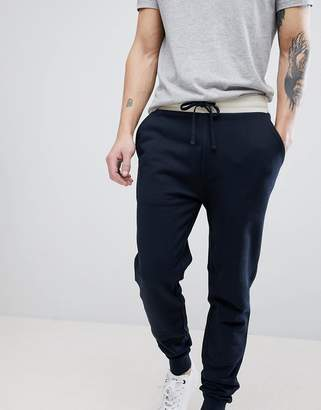 Asos Design DESIGN Skinny Joggers In Navy With Contrast Wasitband