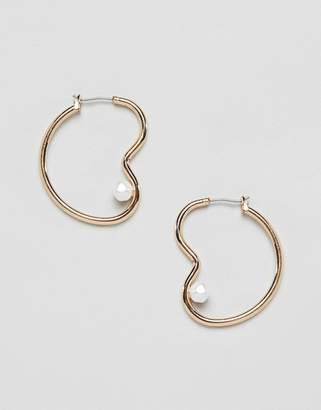 Asos Design DESIGN earrings in abstract open shape with faux fresh water pearl in gold