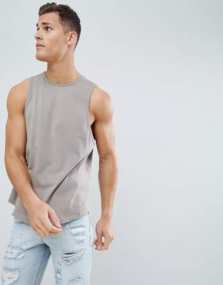 BEIGE ASOS DESIGN relaxed tank with binding and curve hem in