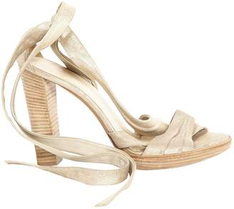 Hermes Gold Leather Sandals