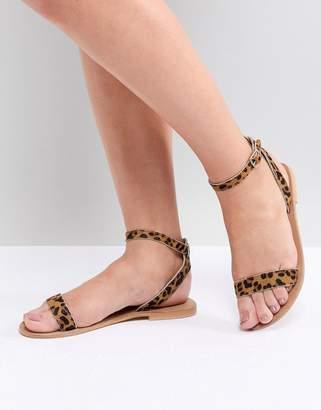 Asos DESIGN Felon Leather Flat Sandals in leopard
