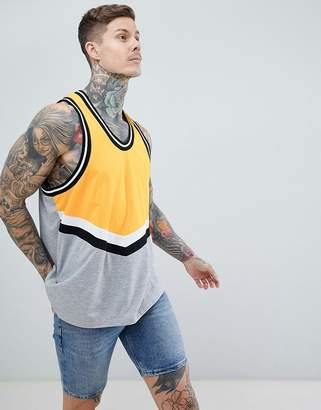 Asos DESIGN oversized longline tank with chevron color block and monochrome tipping in yellow
