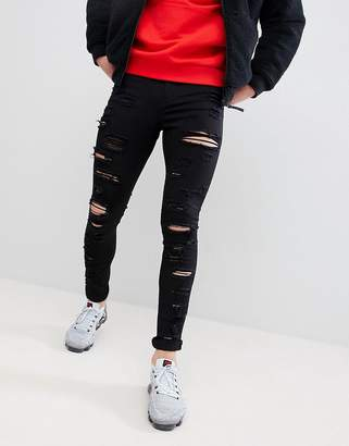 Jaded London Muscle Fit Jeans With All Over Rips In Black