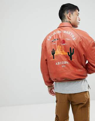 Asos DESIGN festival Plus oversized varsity jacket with embroidery in red