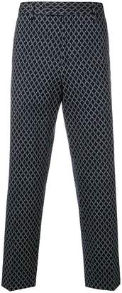 Gucci all-over logo print trousers