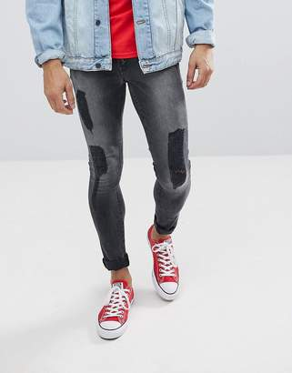 Asos DESIGN Extreme Super Skinny Jeans In Washed Black With Rips