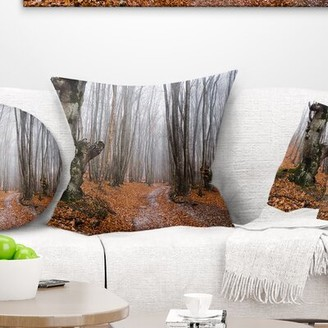 East Urban Home Forest Road Covered by Fallen Leaves Pillow East Urban Home