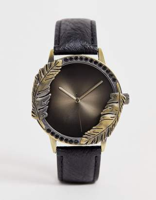 Asos Design DESIGN watch in black with feather and stone detail