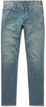 Saint Laurent Skinny-Fit 15cm Hem Distressed Stretch-Denim Jeans $750 thestylecure.com